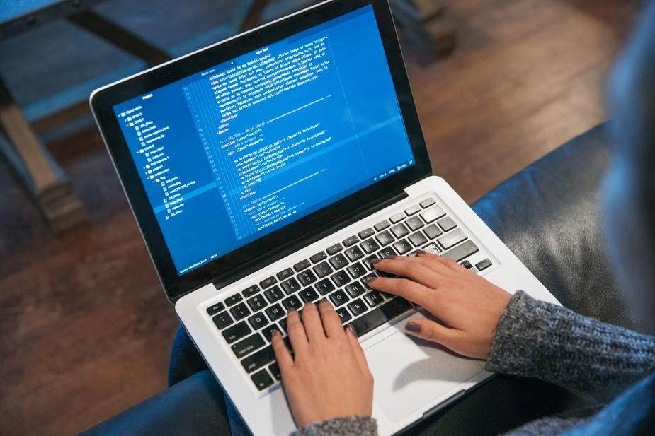 hands-typing-code-on-laptop_925x (1)